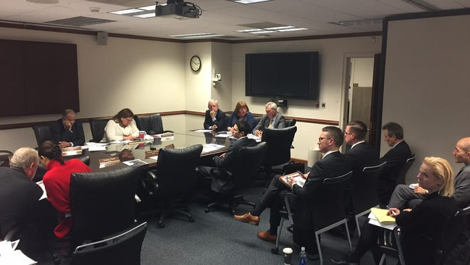 John Schmidt, legal counsel from Mayer Brown, CIBC Global Head of Infrastrucutre Finance Laurene Mahon and CIBC Managing Director David Tweedy at a meeting with the Board of Legislators on Westchester County Airport on Wednesday, Nov. 16, 2016.