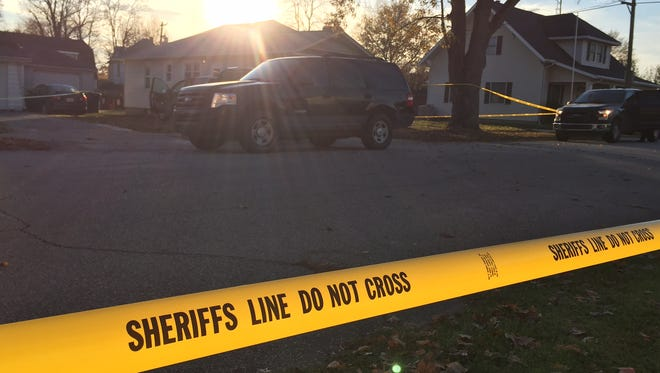 Police tape surrounds a home in Darlington after two bodies were found in the 200 block of Madison Street.