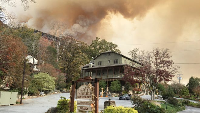 In this photo made available by Don Cason, shows his business, The Esmeralda Inn and Restaurant, which was evacuated due to the proximity of wildfires, Friday, Nov. 11, 2016 in Lake Lure, N.C. The shroud of smoke is making a dent in the tourism economy _ which thrives during the fall season in much of the affected area _ in some part, but Lake Lure could be taking the most concentrated hit. (Don Cason via AP)
