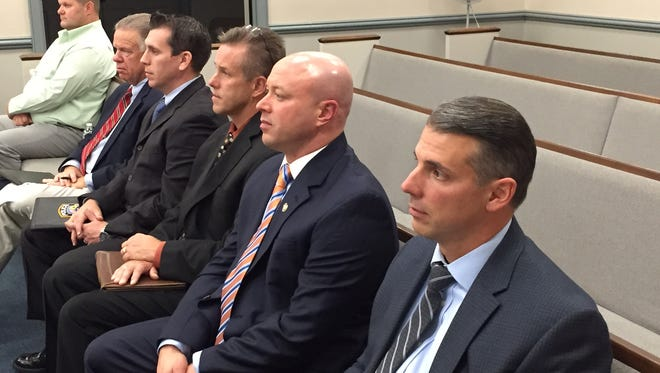 From left, Tom Bailey, the wife of Randolph Police Officer Melissa Bailey; former Randolph Manager John Lovell, Lt. William Harzula, former Chief Robert Mason, current Chief David Stokoe and Lt. Christopher Giuliani, at trial in Morristown on Officer Bailey's gender discrimination claims against the township.