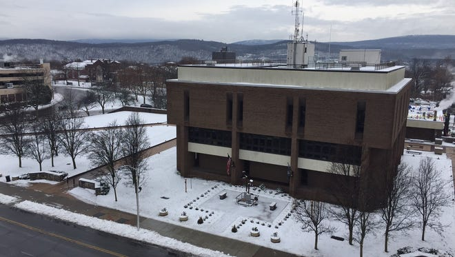 A layer of slushy snow covers the area in front of Poughkeepsie city hall on Monday, Dec. 12, 2016.