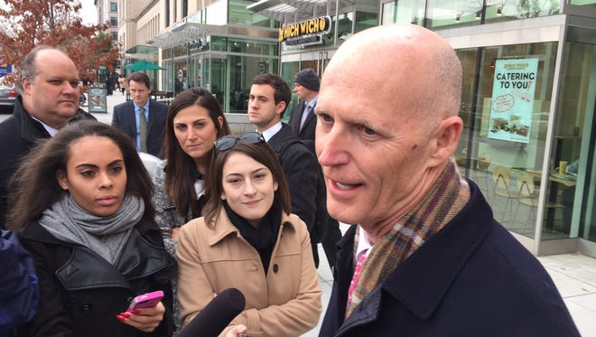Gov. Rick Scott speaks with reporters after meeting with Tom Price in Washington