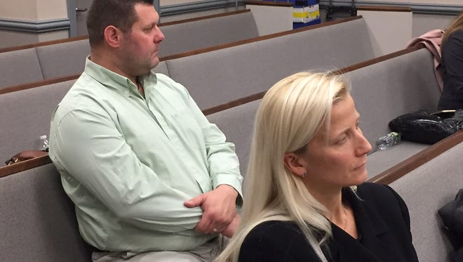 Randolph Police Officer Melissa Bailey at trial on her gender discrimination lawsuit against the township. Her husband, Tom Bailey, is seated behind her.
