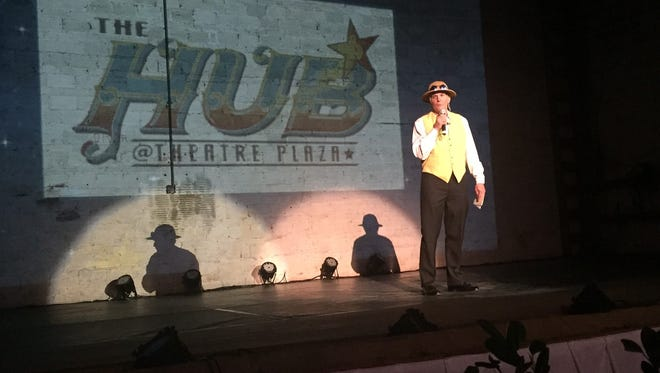 Carl Fetzer, an officer with The Hub of Theatre Plaza, tells the audience what to expect during an evening of entertainment in the old Florida Theatre on Thursday, Dec. 15, 2016, in Vero Beach.