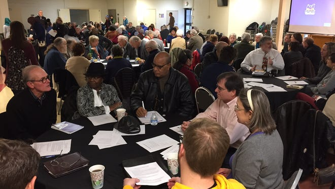 An estimated 150 people from a wide range of faith communities participate Sunday in training for local sanctuary movement.