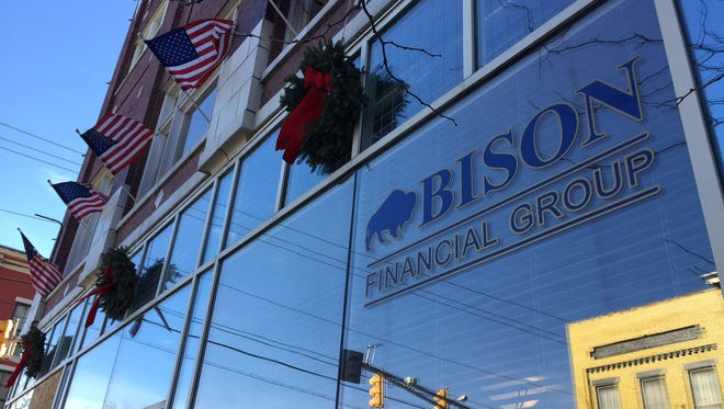 A employee found a bullet and bullet hole Tuesday in the window of Bison Financial Group's downtown building.