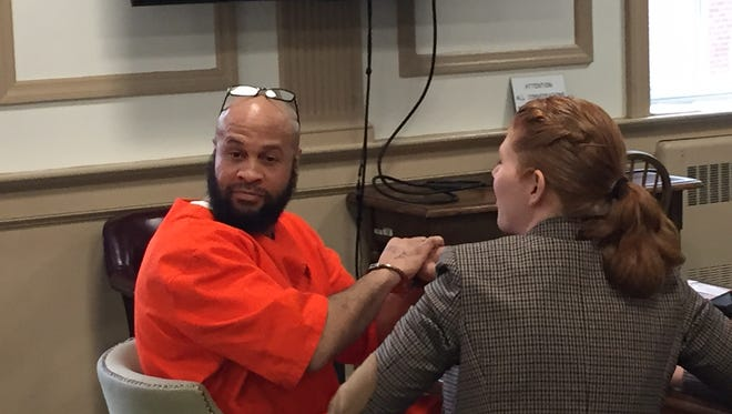 Tyhan Lighty with defense lawyer Maureen Ingersoll at Lighty's sentencing for robbing a parking garage attendant at Morristown Medical Center.