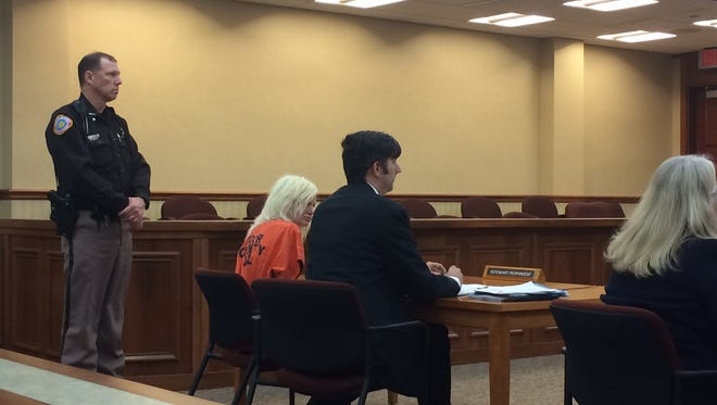 Katherine Johnson, left, in court Monday with her attorney Peter Heyne.