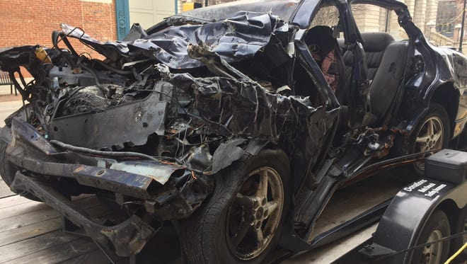 A car driven during a fatal texting-and-driving accident is on display Tuesday, Jan. 24, 2017, outside the Tippecanoe County office building. Jill Biddle, whose daughter died in the crash, uses the mangled vehicle to raise awareness about the dangers of texting and driving.