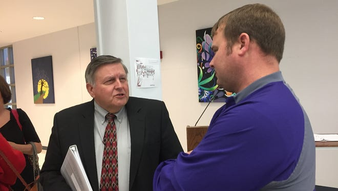 LHSAA assistant executive director Keith  Alexander visits with Logansport  coach  Kevin  Magee during the recent LHSAA meeting in Bossier  City.