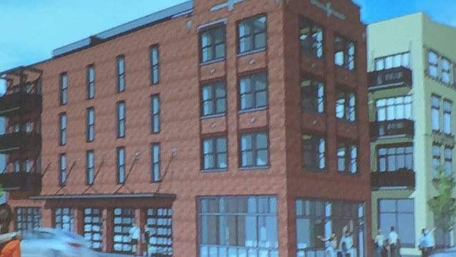 A revived proposal to convert a vacant four-story building in the Historic Third Ward into street-level retail space and seven upper-level apartments has received city approval.
