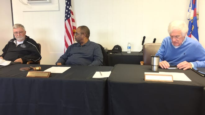 In this Jan. 27, 2017 photo, Princess Anne Town Commissioners Mike Hall (l), President Garland Hayward (c) and District 2 representative Dennis Williams discuss the at-large seat vacancy on the five-member panel. Not  pictured is Town Commissioner Joey Gardner. He attended the meeting.
