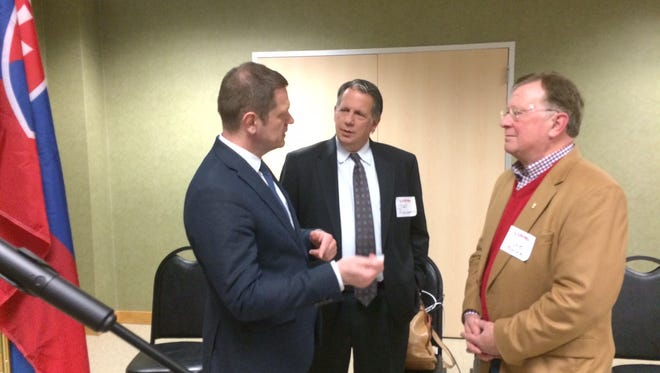 Ambassador Kmec, left, talks with Mayor-President Joel Robideaux and UL Lafayette President E. Joseph Savoie.