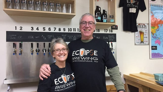 Beth Manning and Chris Mattern are behind the bar in the tasting room of Eclipse Brewing in Merchantville. The couple lives in Haddon Township.