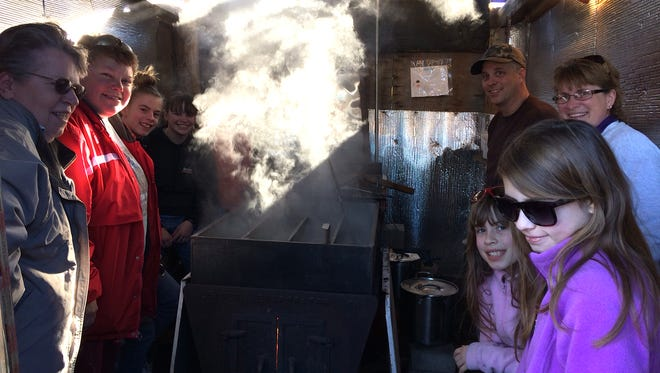 """The Barron-Huether-Cargians huddle up in their """"sugar shack."""" Sap rises in the spring to prepare the maples for budding. The sap falls into the ground at night so that it doesn't freeze and burst the branches."""