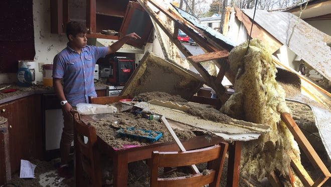 Kenwood High School student Adrian Rojas points to the spot where his brother was standing when a large tree fell on their mobile home in Clarksville after a strong storm passed through Middle Tennessee on Wednesday, March 1, 2017. Francisco Rojas, 12,  was taken to the hospital.