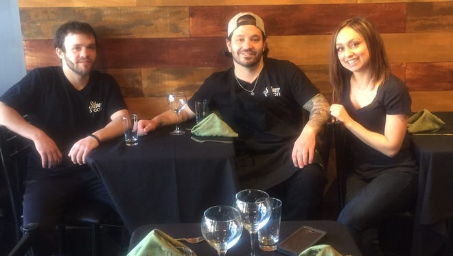 Nicholas Cascetti (from left), Jillian Kelley and  Dennis Kelley share a table at Silver Spoon caterers in Westmont. The trio has big plans for the business.
