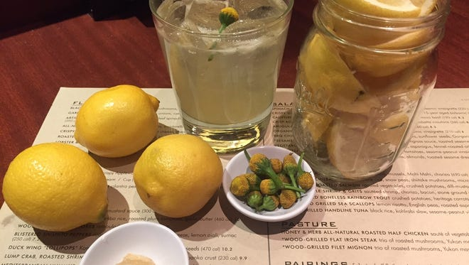 The Botanical Button Cocktail at Seasons 52 includes housemade lemon juice, honey simple syrup, Prairie Organic Vodka and a Buzz Button, or Szechuan Button. The small flower creates a 'buzz' in your mouth when consumed that enhances the cocktail's refreshment.