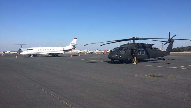 A Black Hawk helicopter and a CRJ 200 PSA Airlines jet at SkyWarrior Inc. flight school in Pensacola.