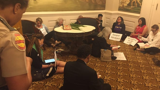 Protesters asking for Medicaid Expansion stage a sit in the Governor's office at the state Capitol.