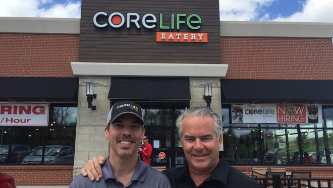 Will Collins, head coach, and John Caveny, vice president of operations, stand outside of CoreLife Eatery which opens May 5 in Florence.