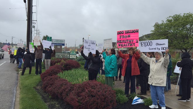 Demonstrators outside the office of Rep. Brad Wenstrup, May 5, 2017