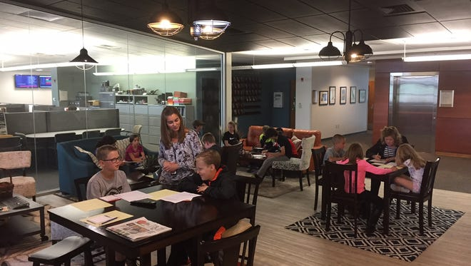 Eyestone Elementary School students hang out at the Coloradoan lounge.