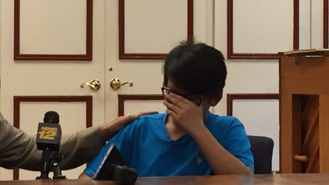 Joel, the 13-year-old son of Arino Massie, breaks down recently while speaking about his father, who was deported.
