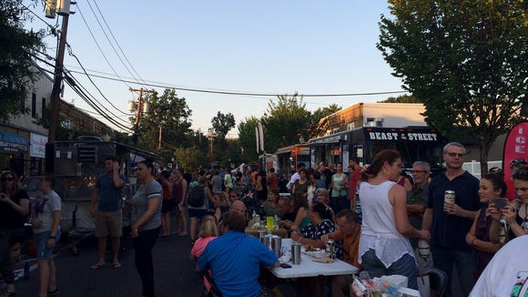Crowds gather at Final Friday in Oaklyn last summer. The food truck fest is back for three months this summer.