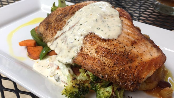 Pan-seared salmon served Tuesday, May 30, 2017, at Town and Gown Bistro in West Lafayette.