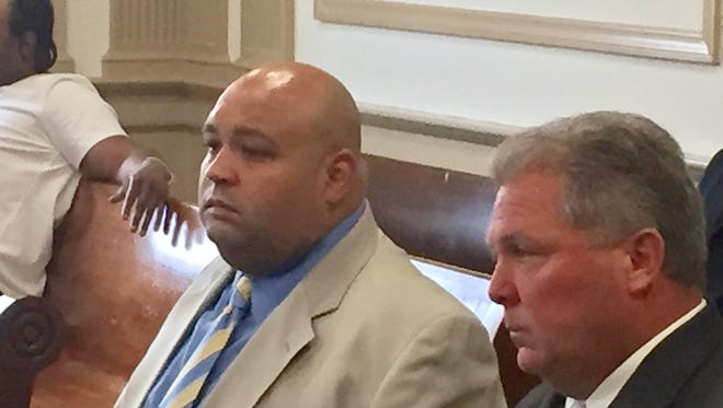 In tan suit, now-suspended Rockaway Township Police Officer Wilfredo Guzman appears in Superior Court, Morristown, on June 5, 2017, with township Police Officer John Reilly.