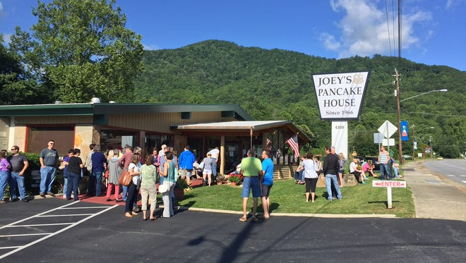 People wait outside for a table at Joey's Pancake House in Maggie Valley in June 2017.