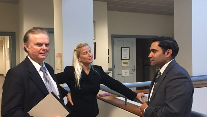 From left, attorney Richard Murray, Randolph Police Officer Melissa Bailey and attorney Omar Lopez during a break in December 2016 at the trial over Bailey's lawsuit against the police department.