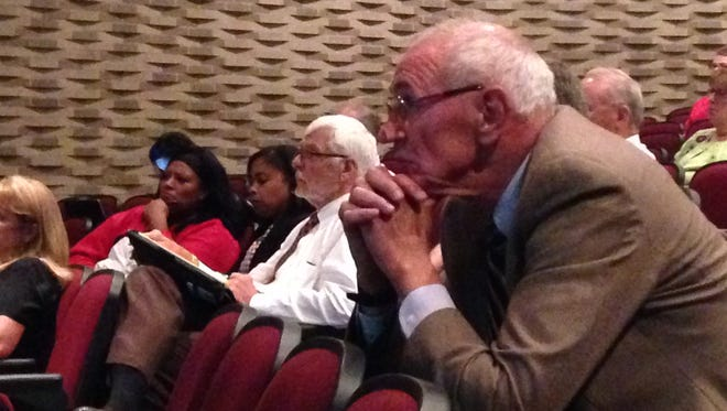 Steve Edwards listens to presentations at Southside Middle School Thursday night