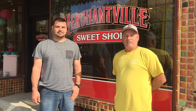 Ramon Garcia (left) and Larry Albright stand in front of their new business, Merchantville Sweet Shop, which opens its doors early Tuesday at the corner of Maple and Centre.
