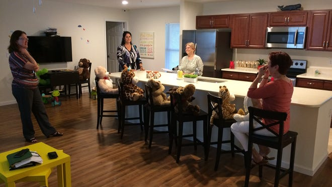 A look inside: Debbie Butler, right, shows off the home's open floor plan during a tour last winter.