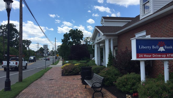 LIberty Bell Bank is one of the few Lenola neighborhood businesses  on Camden Avenue in Moorestown that recently upgraded its sidewalk to brick, planted shrubs and flowers and erected an old-fashiond street lamp