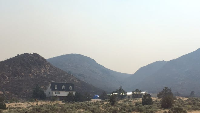 Smoke is seen from the Winnemucca Ranch Fire north of Reno on Wednesday, July 5, 2017.