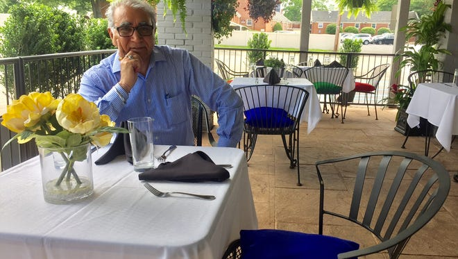 Owner Rewal Thind enjoys the newly decorated patio of Monsoon Fine Indian Cuisine. The Cherry Hill restaurant opened in February, and is Thind's second location.