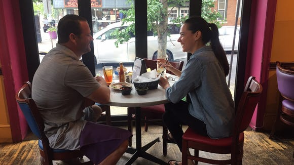 Sam and Lisa Girgenti of Haddonfield enjoy lunch at Tortilla Press in Collingswood. The eatery recently added more large windows that serve to open much of the space up to the open air in nice weather.