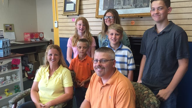 The Neltner family: (First row) Greg and Beth, (second row) Dylan, 9, and Ryan 11, (third row) Samantha, 14, Cece, 12, and Teddy, 15.