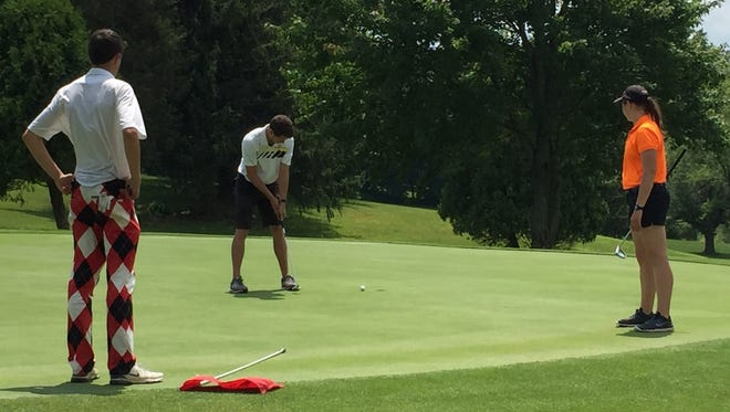 Pleasant's Jed Charpie makes a putt during a Heart of Ohio Junior Golf Association tournament at Valley View earlier this season.