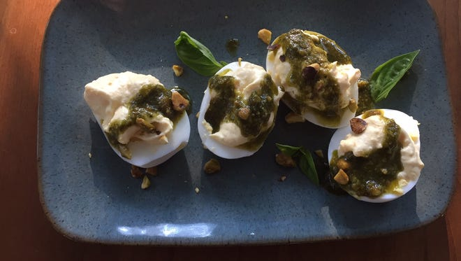Deviled eggs with pesto and chopped pistachios