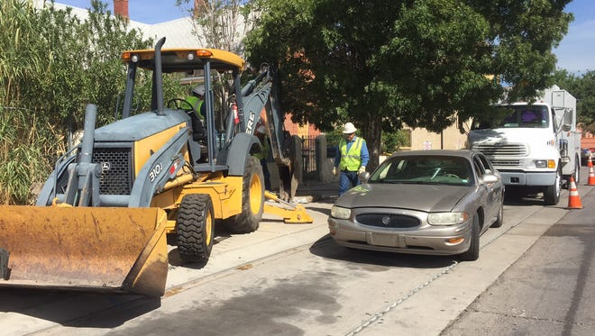 Texas Gas Service crews were tearing up a patch of sidewalk on Chihuahua Street in the planned footprint for the city's Downtown arena project.