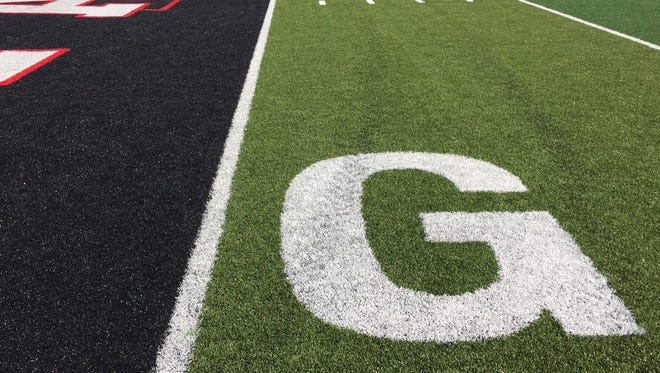 The new goal line in Harding Stadium is shown as artificial turf was installed over the summer.