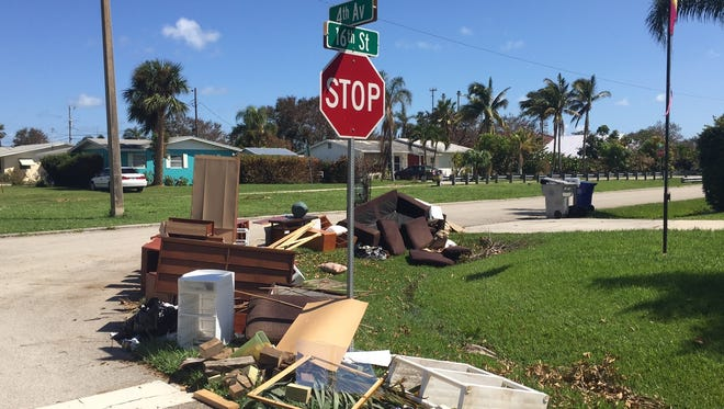 More than 30 homes in the Rockridge neighborhood, mostly south of 16th Street and east of Fourth Avenue in Vero Beach, suffered flood damage in Hurricane Irma, according to Indian River County officials. Victims placed damaged furniture outside for trash collection.