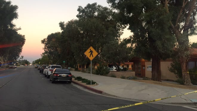 Palm Springs police investigate a double stabbing on East Tachevah Drive on Sept. 19, 2017.