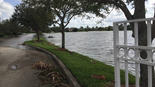 The retention lake in Hunter's Run in south Indian River County overflowed Sept. 11, 2017 after Hurricane Irma, stranding residents who could not drive out of their neighborhood without trucks or SUVs. County officials said neighborhoods are designed to fill lakes and roads to keep homes from flooding.