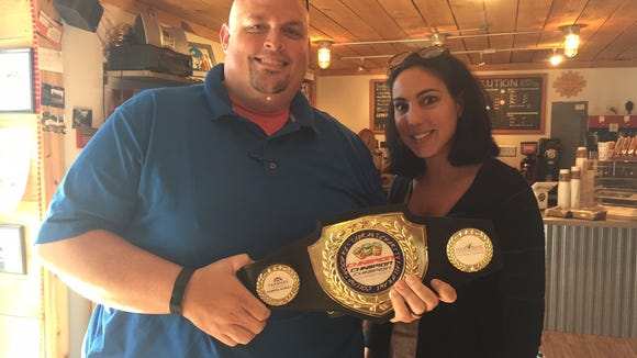 Jason Rameriz and Emily Oleaga-Talley show off the 2017 Collingswood Charity Fall Brawl belt.