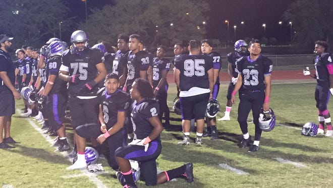 Cesar Chavez players gather for a post-game meeting after beating North.